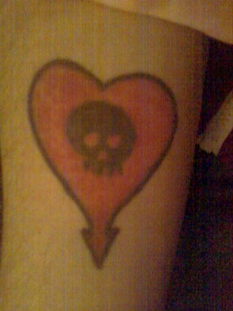 John Laszkow's first tattoo  of a heart and skull for the band Alkaline Trio